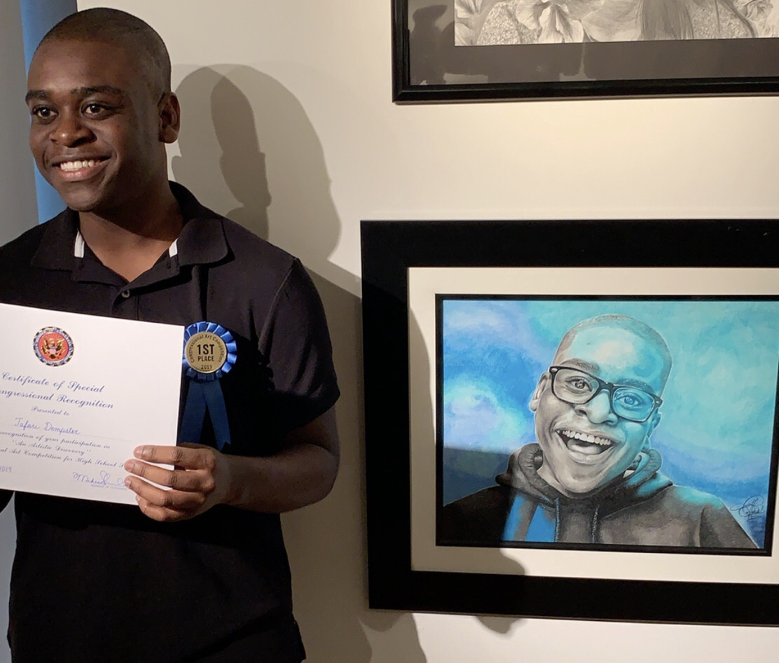 Tafari Dempster stands next to his winning piece