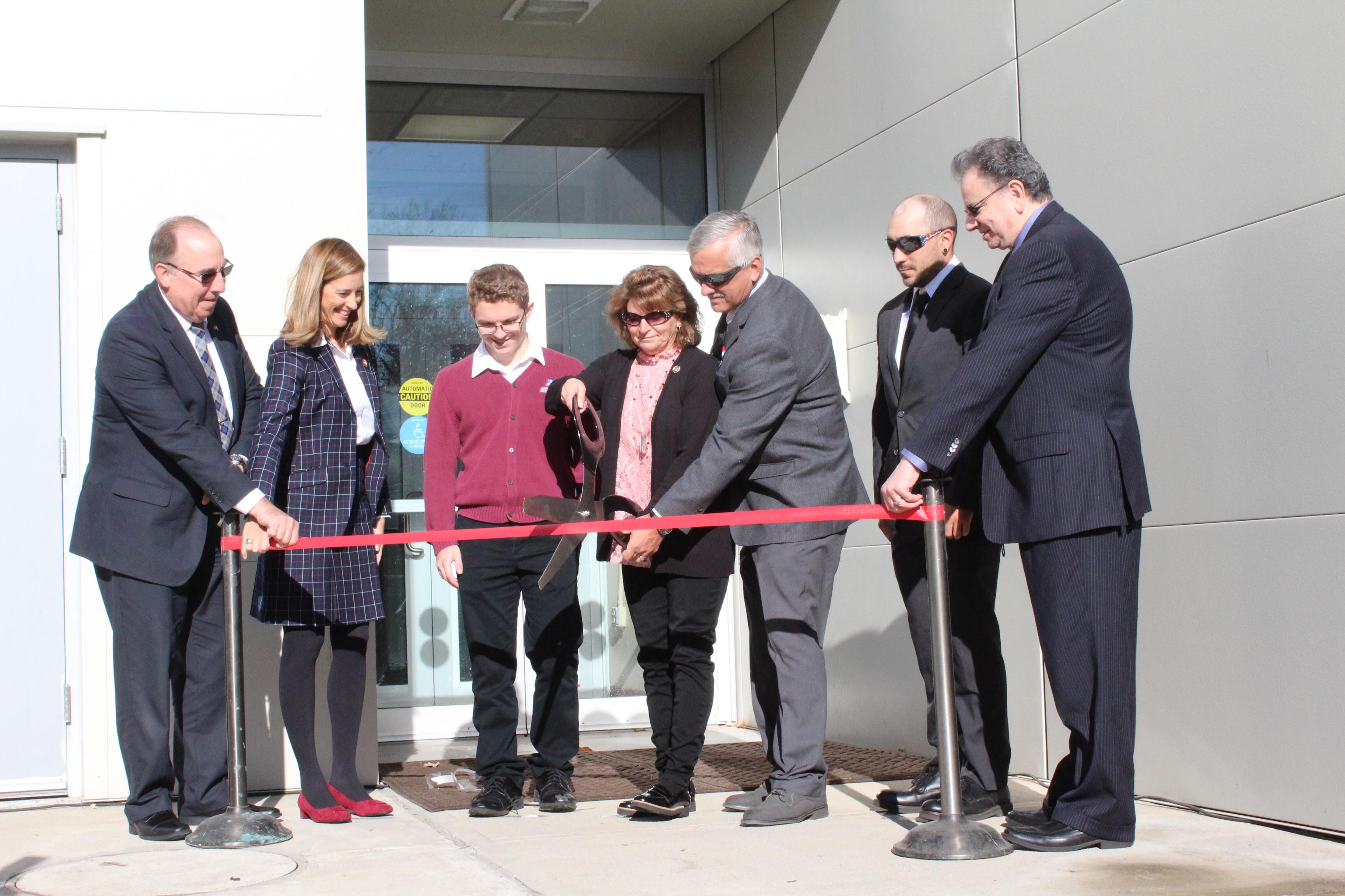Hopatcong Councilwoman Dawn Roberts, Sgt. Kirspel's mother, cuts the ribbon for the Ballistic Evaluation Center at Picatinny Arsenal